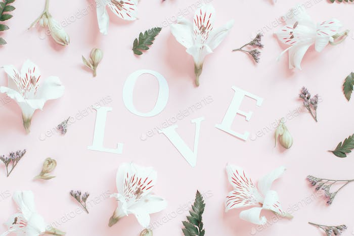 Flowers and word LOVE on a light pink background