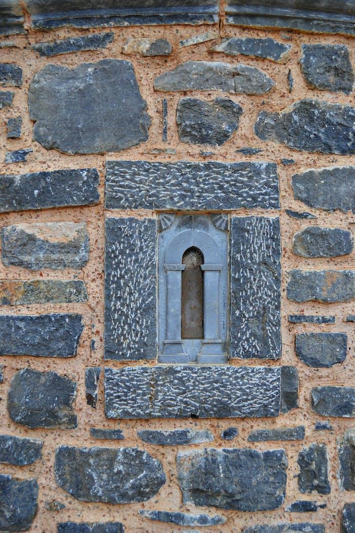 Old church wall with window on Greece