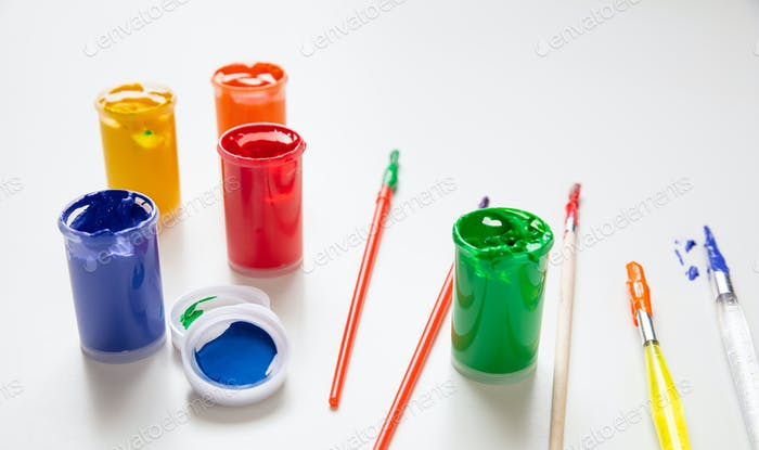 Colorful finger paints set on white color background