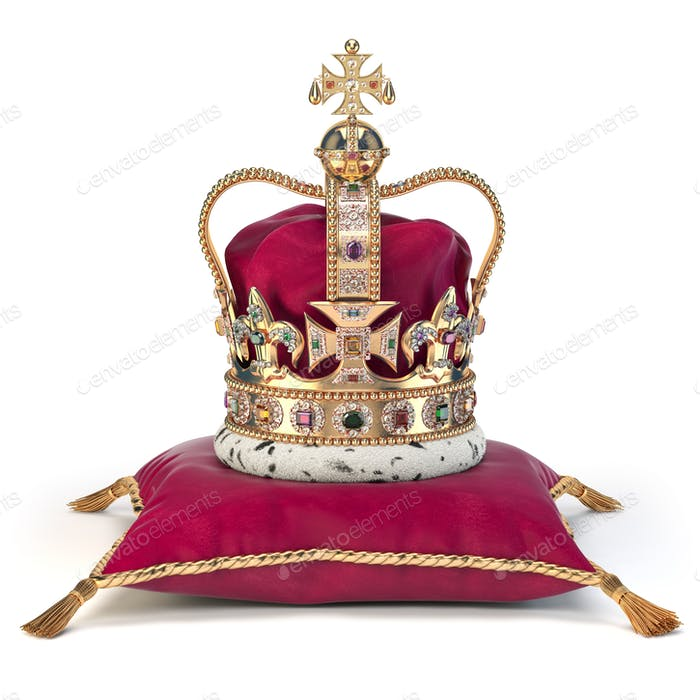 Golden crown on red velvet pillow for coronation. Royal symbol o