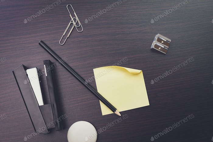 blank sticker and pencil on the wooden table