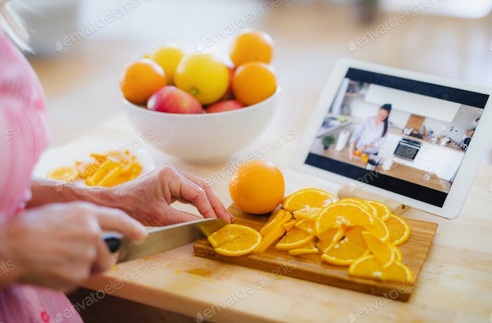 Unrecognizable woman preparing food in kitchen indoors, following food vlogger