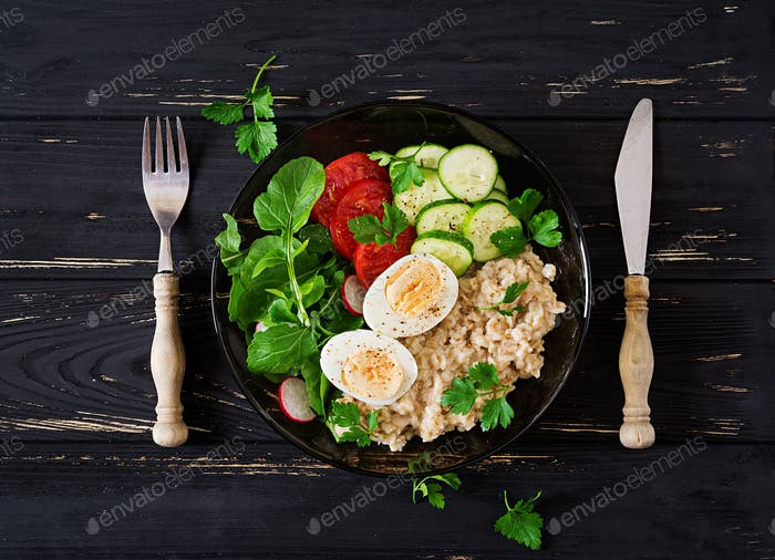 Healthy salad of fresh vegetables - tomatoes, cucumber, radish, egg