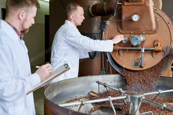 Workers Operating Roasting Machine