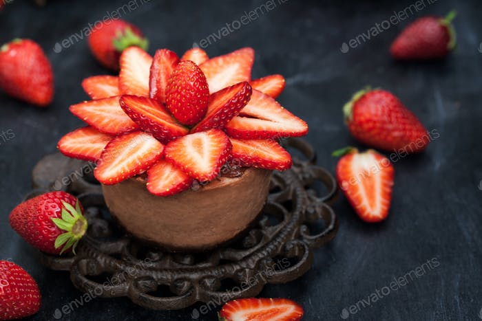 Mini chocolate cheesecake  dessert decorated with fresh strawber