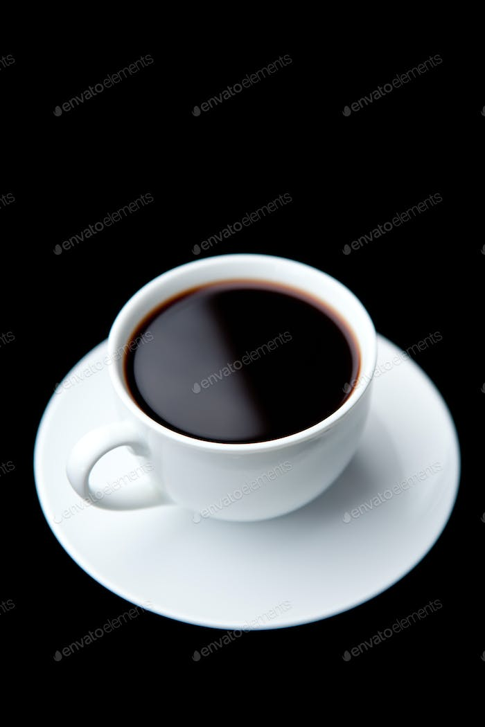 Cup of coffee against a black background