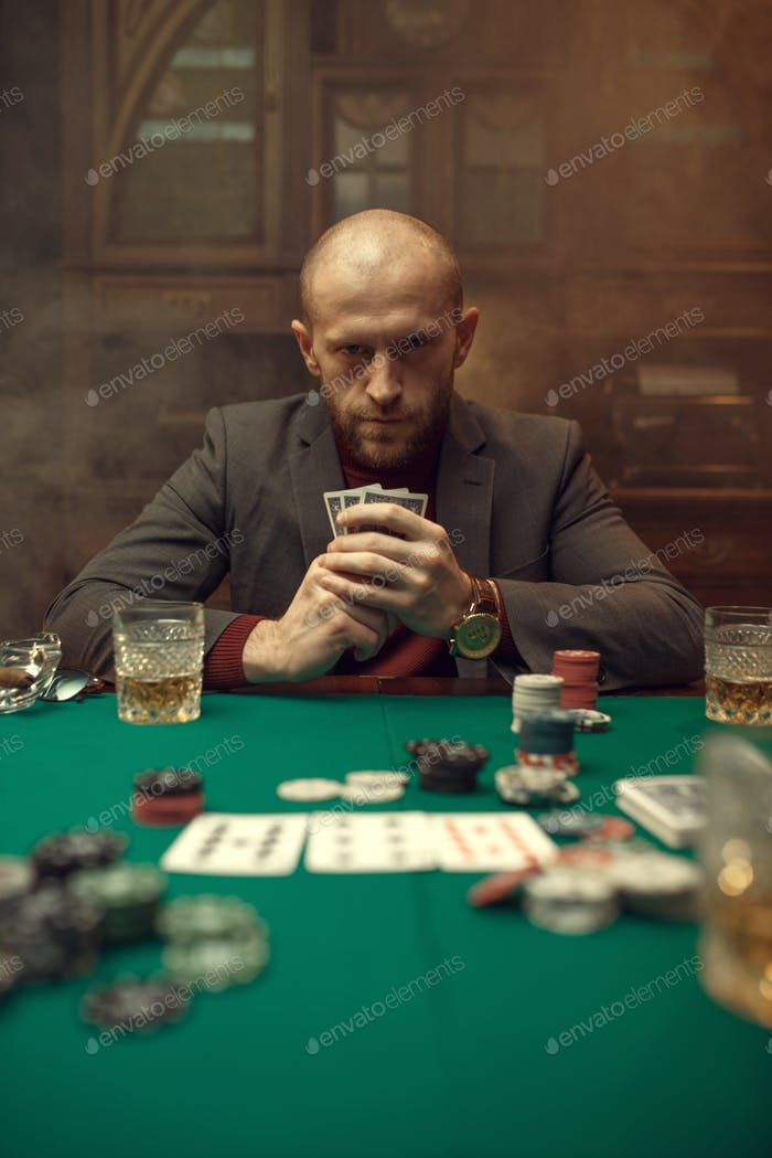 Poker player in suit plays in casino