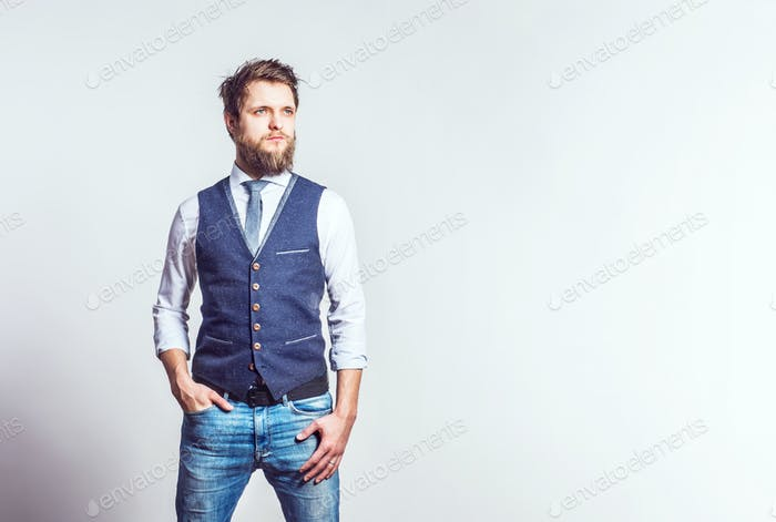 Portrait of a young hipster man in a studio. Copy space.