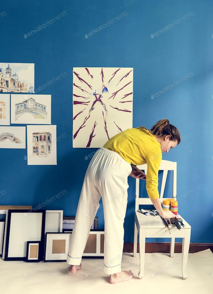 Young artist girl creaiting an artwork