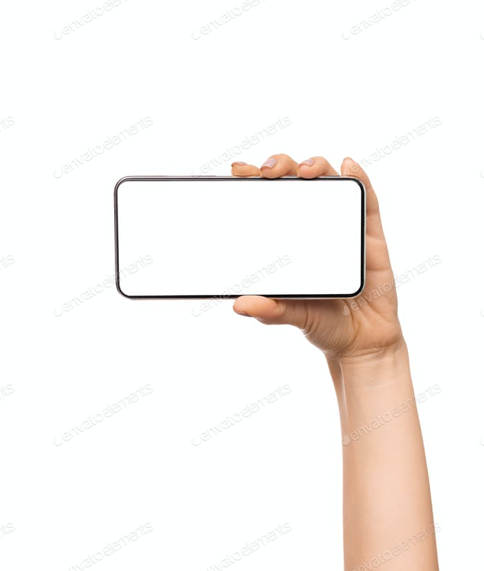 Woman holding frameless smartphone with white blank screen