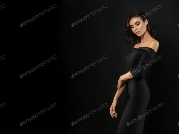 Young beautiful woman wearing black evening dress