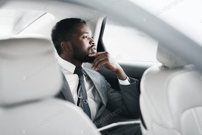 Pensive Businessman Sitting In Car Thinking Commuting To Work