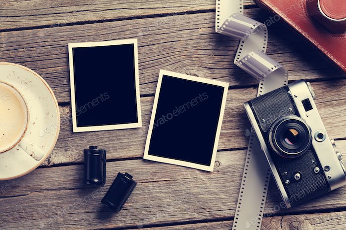 Vintage camera and blank photo frames