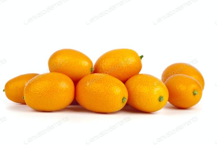 Few kumquat fruits