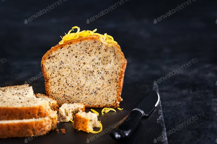 Lemon and poopy seeds pound cake on dark background
