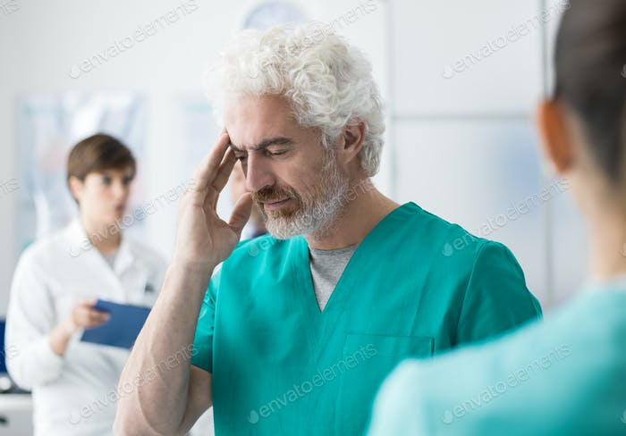 Healthcare worker having an headache