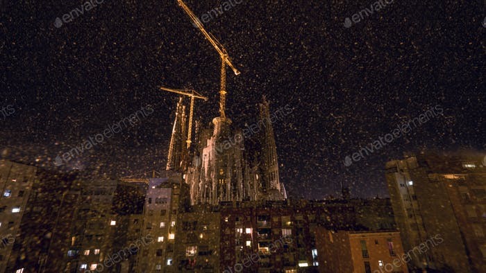 Night view of Sagrada Familia and houses in Barcelona, Spain