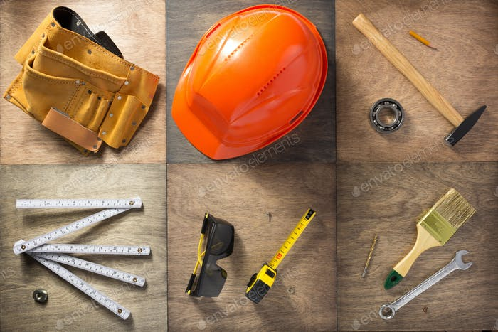 set of tools at wooden background