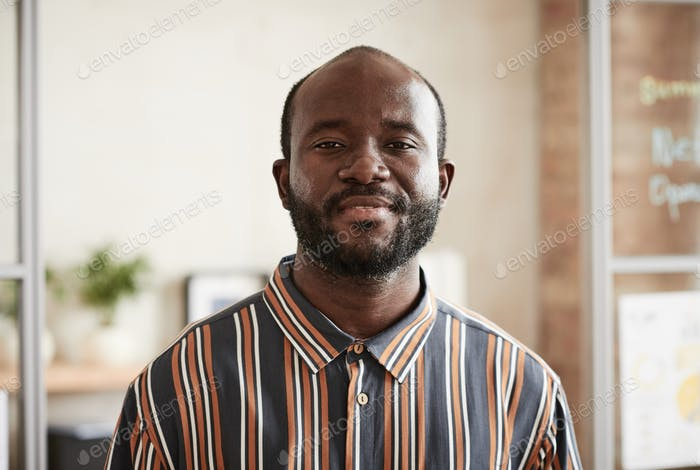 African man standing at office