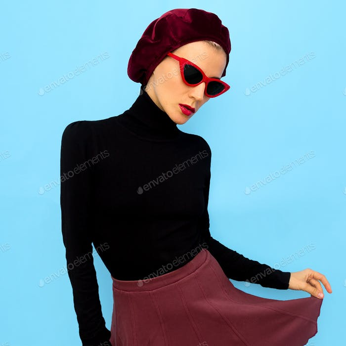 Model in a fashion accessory beret and sunglasses. Vintage style