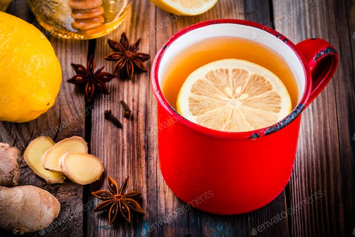 Hot tea with lemon in a rustic mug with honey