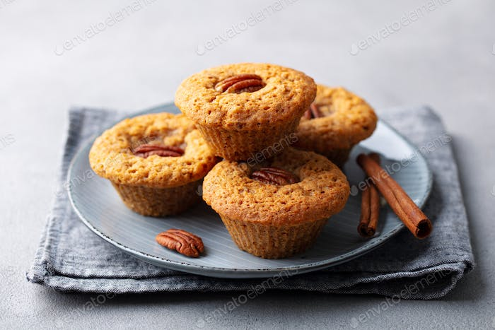 Pecan Nut Muffins on a Plate. Grey Background. Close up.