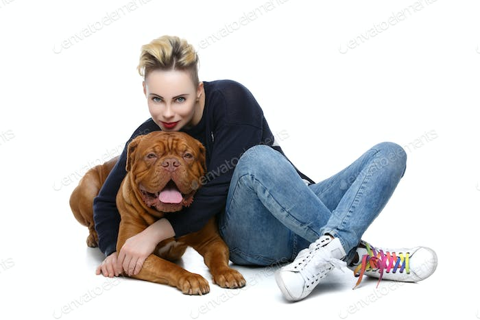 Girl with big brown dog