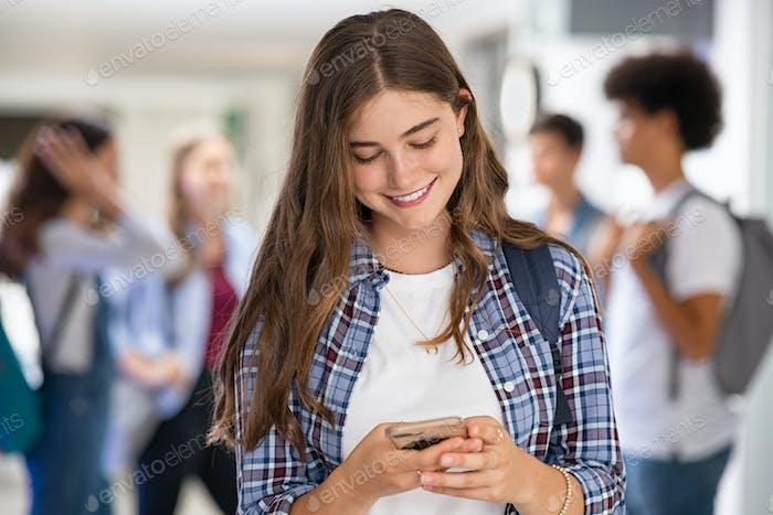 Girl in college school using smartphone