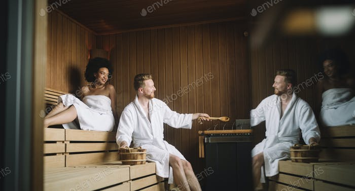 People enjoying sauna health benefits and relax