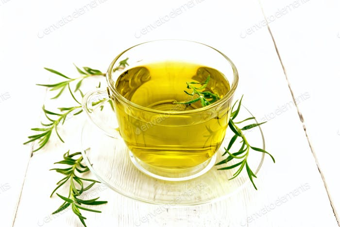 Tea of rosemary in cup on light board