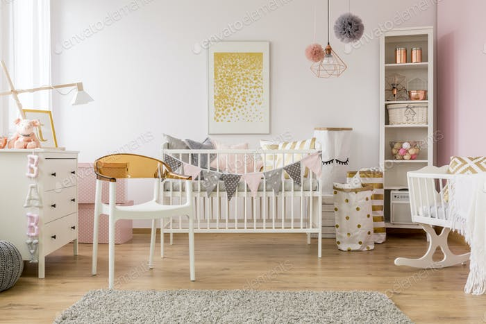 Baby bedroom with white chair