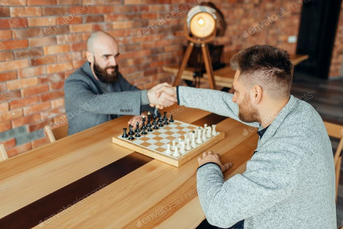Chess players shake hands before the game