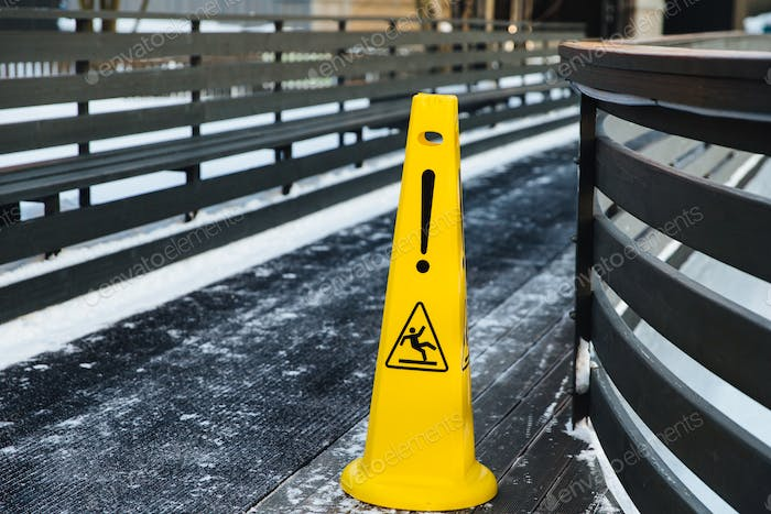Be aware of slippery road. Slippery yellow surface sign. Wet floor sign. Icing concept