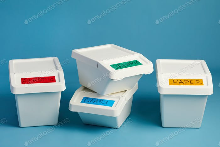 Labeled Waste Containers on Blue