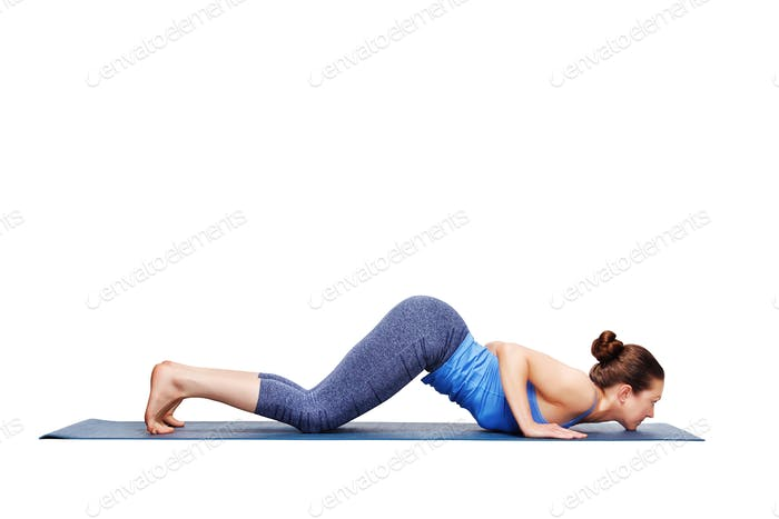 Sporty fit woman practices yoga asana Ashtangasana