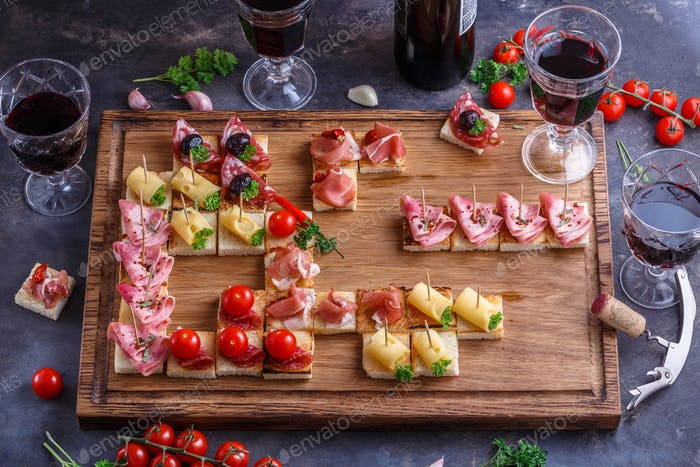 Bruschetta or authentic traditional spanish tapas set for the lunch table.