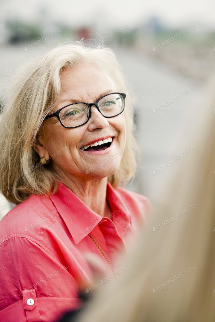 Close-up of cheerful senior woman outdoors