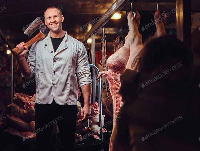 A butcher in a meat factory.
