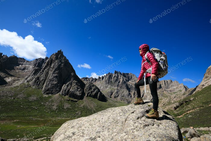 Hiker enjoy the view on mountain top