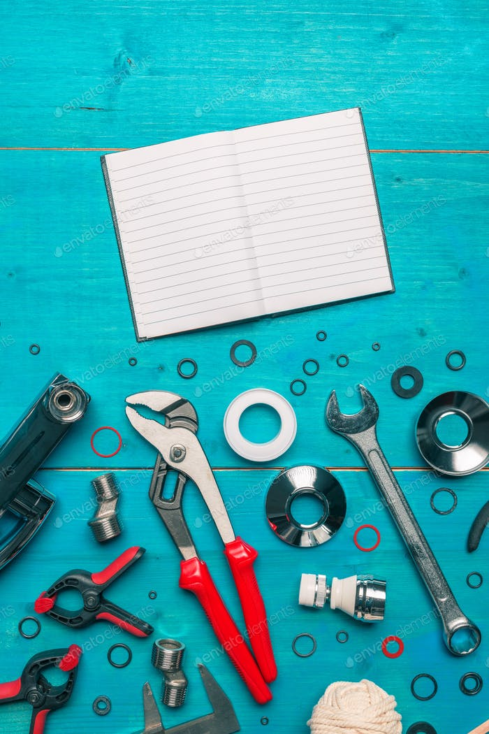 Plumbing tools and blank notebook mock up