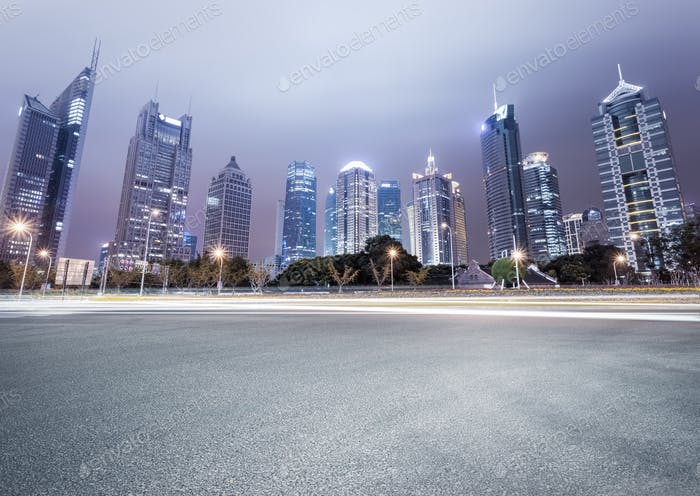city avenue with modern buildings at night