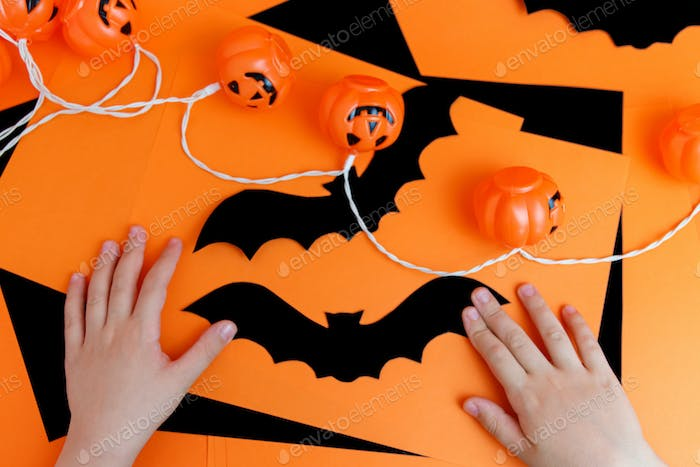 Little boy playing with spooky halloween decorations.