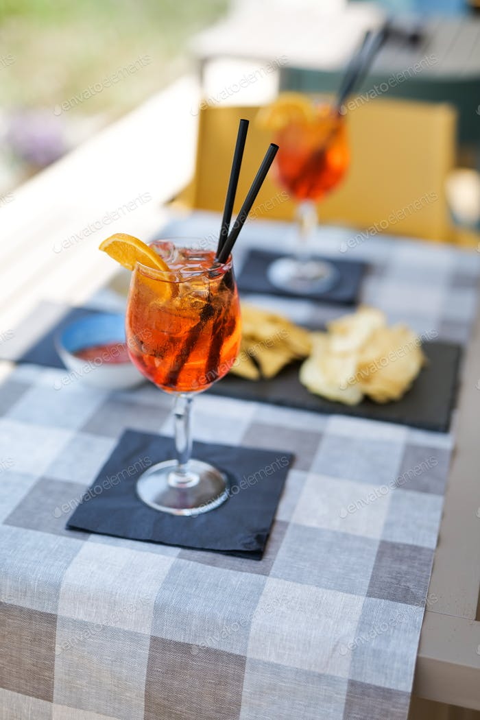 aperitif with aperol crisps on a table