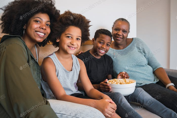 Grandmother, mother and children together at home.