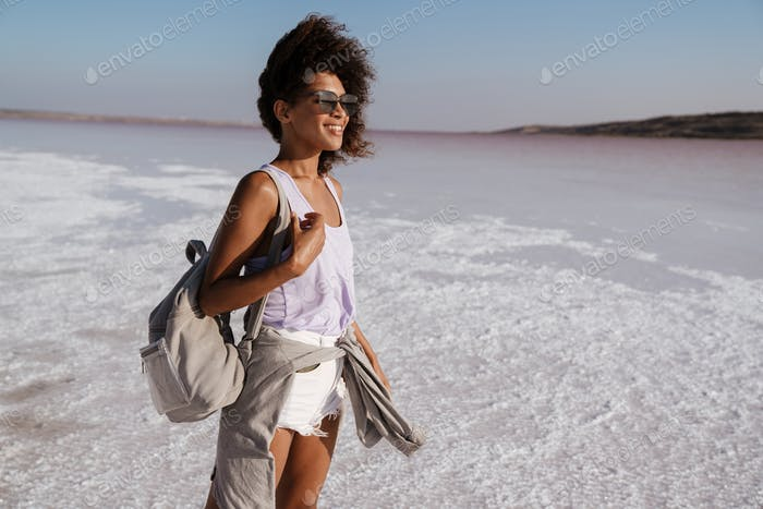 Smiling attractive african woman walking