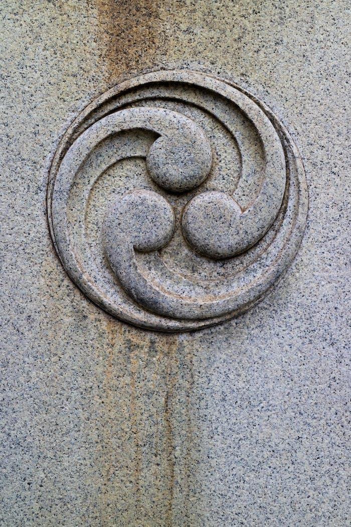 Japanese tomoe cut in stone