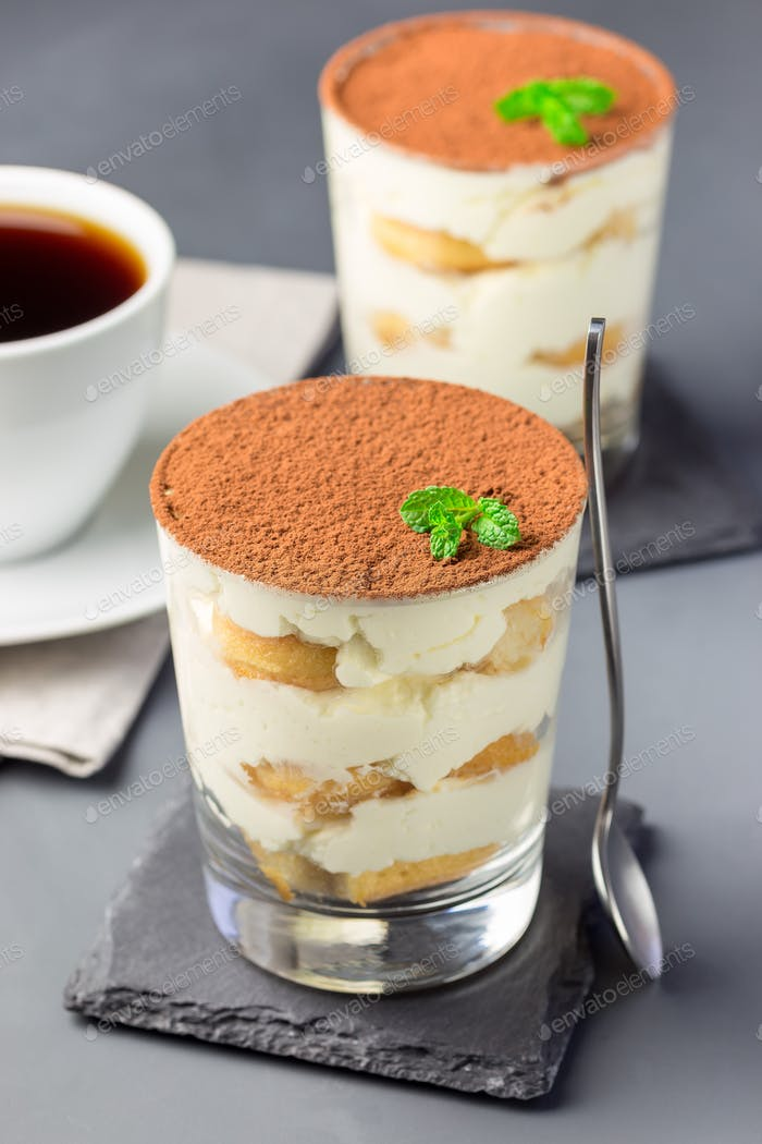Traditional italian Tiramisu dessert cake in a glass, decorated