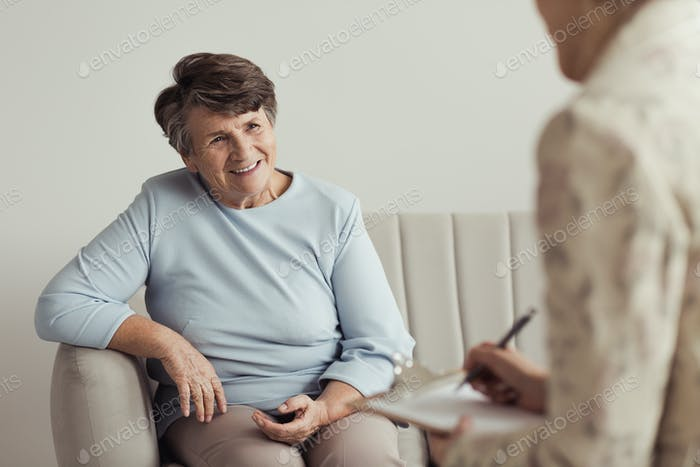 Smiling grandmother and financial counselor