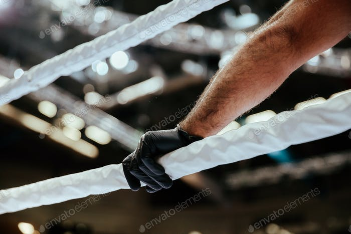 referee hand in black glove