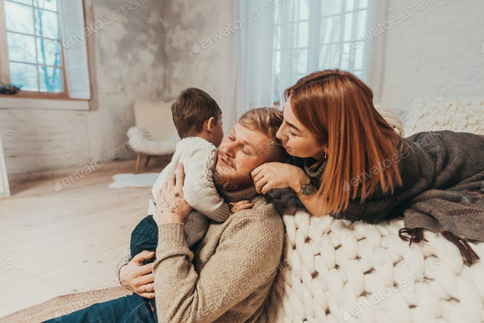 Mom, Dad and Little Son Spends Time Together